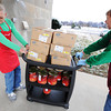 Church members and volunteers Hank Hull (left) and David Mason bring in a carload of turkey breast and yams for the Christmas Dinner Monday morning Dec. 23, 2013, at First Community Church in Joplin. The Christmas Dinner will be held from 11 a.m. to 2 p.m. Christmas Day.<br /> Globe | T. Rob Brown