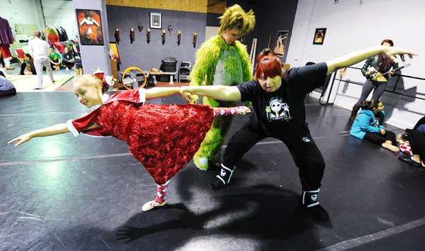 Kaye Lewis (right), artistic director, works with Joey Williams (center), 14, of Neosho, who portrays the Grinch and Kailan Peters, 10, of Carl Junction, portraying Cindy Lou Who during a rehearsal for the ballet version of The Grinch Monday evening, Dec. 2. 2013, at the Midwest Regional Ballet owned by Kaye Lewis, artistic director.<br /> Globe | T. Rob Brown