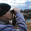 Lawrence Herbert, bird bander, searches the trees for birds Saturday morning, Dec. 28, 2013, outside the Wildcat Glades Conservation & Audubon Center in Joplin during the bird count.<br /> Globe | T. Rob Brown