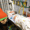 Elf Heather Lesmeister, director of Children's Miracle Network for Freeman, visits Ravyn Cooley, born Dec. 12 and currently in the NICU at Freeman West in Joplin.<br /> Globe | T. Rob Brown