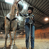 Marcia Weeks of Pittsburg, Kan., stands next to Zara, her Arabian mare, Wednesday afternoon, Dec. 19, 2013, at the stables in rural Kansas where she keeps her two horses.<br /> Globe | T. Rob Brown