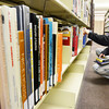 Ben Callihan of Joplin looks through the Joplin Public Library's selection of art and drawing books Monday evening, Dec. 30, 2013, as he looks for a project for him and his son. Callihan said he bought his son a drawing book for Christmas and through that gift also garnered a love for the art for himself. Some library patrons were indoors to keep out of Monday's cooler temperatures.<br /> Globe | T. Rob Brown