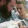 Globe/Roger Nomer<br /> Tom and Amber hold their 10-day-old daughter Mary at the Freeman NICU on Monday afternoon. The couple is thankful for being able to stay at the Ronald McDonald House, close to their daughters, but hopes to be able to return home with their girls soon.