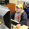 Michael Eggensperger of Joplin and other Joplin Public Library patrons utilize the computer lab Thursday afternoon, Dec. 12, 2013.<br /> Globe | T. Rob Brown