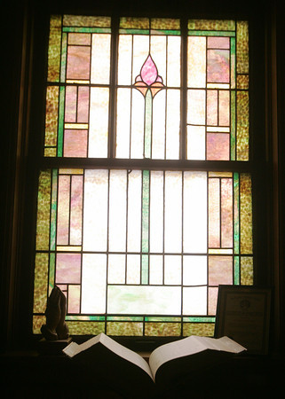 Globe/Roger Nomer<br /> Decorative stained glass windows also line the walls in a study room at the First Presbyterian Church in Carthage.