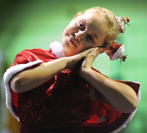 Kailan Peters, 10, of Carl Junction, portrays Cindy Lou Who during a rehearsal for the ballet version of The Grinch Monday evening, Dec. 2. 2013, at the Midwest Regional Ballet owned by Kaye Lewis, artistic director.<br /> Globe | T. Rob Brown