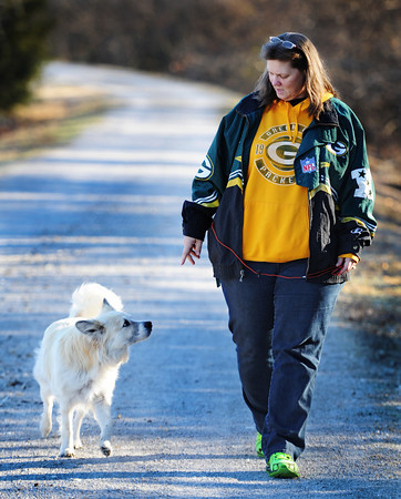Companions Kim Fowler of Carl Junction and her dog Sam walk along the Frisco Trail near Royal Heights in Joplin.<br /> Globe | T. Rob Brown