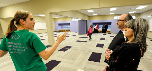 Joplin East Middle School eighth grader Emma Willerton (left), a WEB (Where Everybody Belongs) tour guide, leads Gary and Teresa Severs, parents of eighth grader Garret Severs, as they take their first look inside the new East Middle School building Monday afternoon, Dec. 16, 2013.<br /> Globe | T. Rob Brown