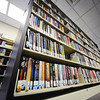 Due to space constraints, large print books are forced to be shelved on the bottom shelf which can be difficult for senior citizens to reach, as seen Thursday afternoon, Dec. 12, 2013.<br /> Globe | T. Rob Brown