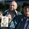 Globe/Roger Nomer<br /> James, left, and Earl Miller hold a photo of their uncle Norman Miller.