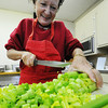 Church member and volunteer Denise Winans of Joplin slices celery for the Christmas Dinner dressing Monday morning Dec. 23, 2013, at First Community Church in Joplin. The Christmas Dinner will be held from 11 a.m. to 2 p.m. Christmas Day.<br /> Globe | T. Rob Brown