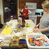 Globe/Roger Nomer<br /> Before a visit with her daughters in the Freeman NICU, Amber Turner prepares lunch in the kitchen of the Ronald McDonald House on Tuesday afternoon. The house makes sure to stock the kitchen for meals as well as snacks for families to take with them to the hospital.