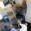 Next Generation Gay-Len Plumbing of Joplin plumbers Drew Perrin (below) and Luke Alexander install a new CMA-Ventless CMA-180 professional high-temperature dishwasher recently at Soul's Harbor in Joplin. The local charity organization has been remodeling its kitchen to get ready for Christmas dinner.<br /> Globe | T. Rob Brown