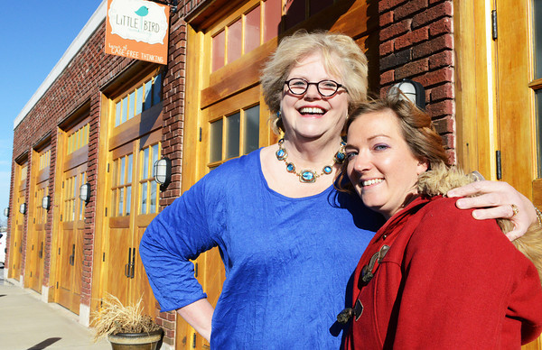 "Niki Corcoran (right) smiles next to one of her mentors Ann Leach, both of Joplin, next to ""the carriage house"" offices behind the Gryphon Building in downtown Joplin Tuesday afternoon, Dec. 31, 2013.<br /> Globe 