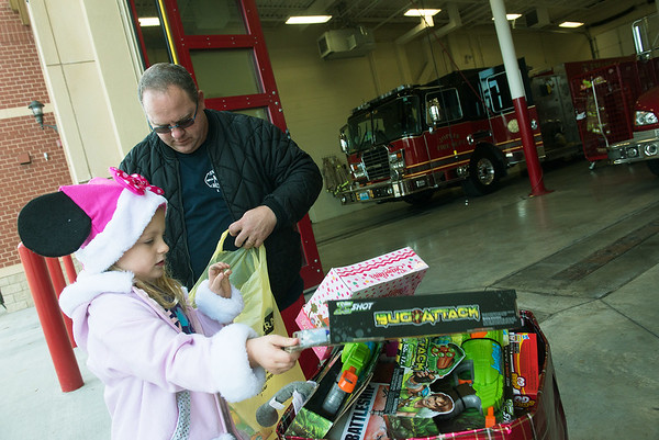Globe/Roger Nomer<br /> Joplin Fire Captain Adam Grimes and daughter Neeley, 5, collect donations on Monday at Fire House No. 4.