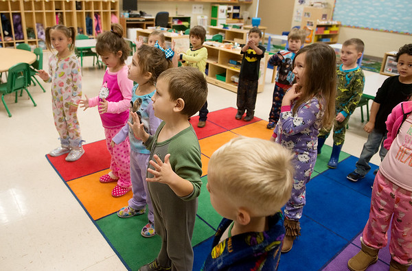Globe/Roger Nomer Woodland Heights Elementary preschoolers start the day with a song on Friday morning. The school has expanded its preschool classes under Superintendent Melinda Moss.