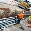 Globe/Roger Nomer<br /> Workers install conduits for electrical lines on Wednesday along Highway 76 in Branson.