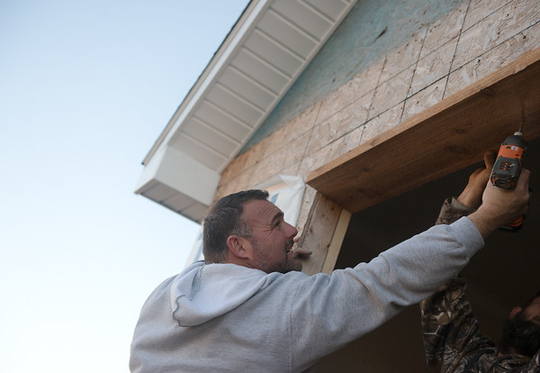 Globe/Roger Nomer<br /> Joe Abruzzo works on a house on Thursday on Kingsdale in Joplin.