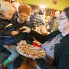 Globe/Roger Nomer<br /> Tera Linehan gives a sample of candy to Andrew Hedeman, 3, and his grandmother Jan, Lockwood, on Monday during the reopening of the Candy House.