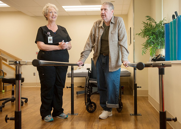 Globe/Roger Nomer<br /> Scott Prince and Lee Ann Luebber talk about his rehab work at Via Christi in Pittsburg on Wednesday, Dec. 14.