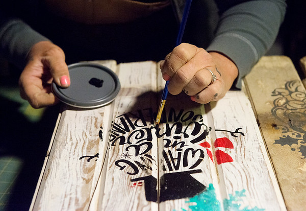 Globe/Roger Nomer<br /> Angie Gastel paints a sled in her studio on Friday, Dec. 16, in Jasper.