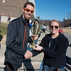 Globe/Roger Nomer<br /> Austin Bunn, Nevada, accepts the trophy for first overall male finisher from Sally Pennington, race director, following Saturday's Chilly 5K at the south Joplin YMCA.