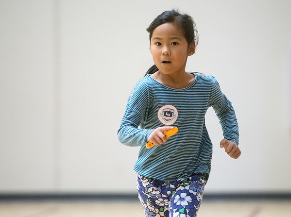 Globe/Roger Nomer<br /> Mai Dang, first grade, runs laps on Monday, Dec. 5, at Columbia Elementary.