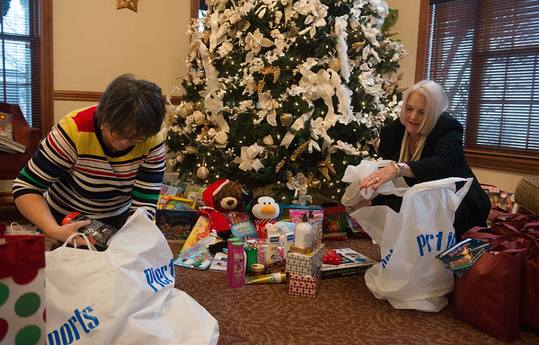 Globe/Roger Nomer<br /> Shirley Hylton, house manager at the Ronald McDonald House, left, and Linda McIntosh, volunteer program manager for Freeman, unpack donations on Friday at the Ronald McDonald House. The gifts were collected by members of the Freeman Auxiliary, from money raised throughout the year.