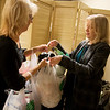 Globe/Roger Nomer<br /> Laura Samford receives donations from Angela Meyer, right, on Wednesday in Pittsburg.
