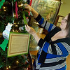 Globe/Roger Nomer<br /> Angie Casavecchia, Jasper County Public Adminstrator, arranges ornaments on Monday on the Adoption Tree at the Jasper County Courthouse.