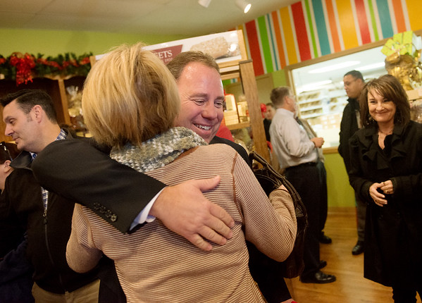 Globe/Roger Nomer<br /> Co-owner Wayne Adolphsen gets congratulations from Michelle Wade on Monday during the reopening of the Candy House.