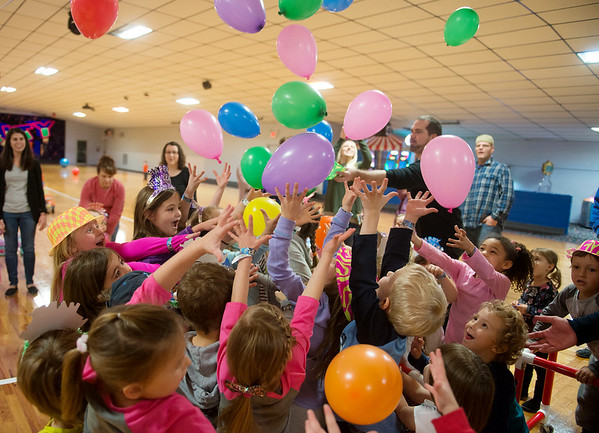 Globe/Roger Nomer<br /> Children reach for balloons during an early New Year's Eve celebration on Thursday at Roller City in Joplin.