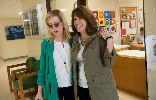 Globe/Roger Nomer<br /> Harrison Superintendent Melinda Moss talks with Woodland Heights Principal Debbie Wilson about leaving the district during a visit to the school on Friday.