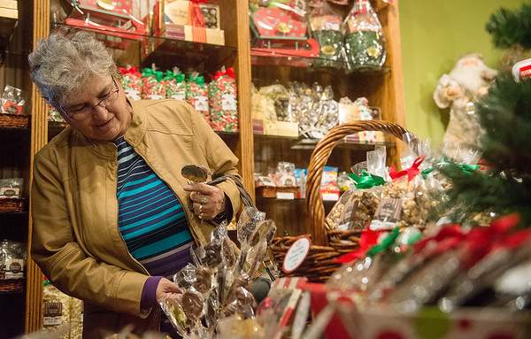 Globe/Roger Nomer<br /> Sharon Feagan, Carthage, shops on Monday at the reopened Candy House.