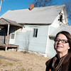 Globe/Roger Nomer<br /> Ally Barnes, economic development director for Sarcoxie, talks about an abandoned building on Business Highway 37 in Sarcoxie on Thursday.