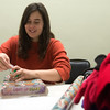 Globe/Roger Nomer<br /> Amy Fink, house manager at Souls Harbor, wraps presents on Tuesday at the shelter.