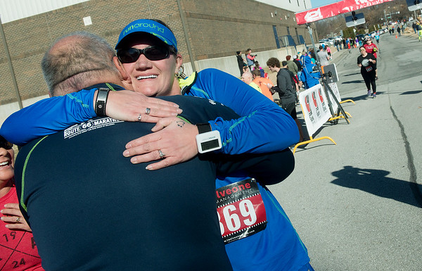 Globe/Roger Nomer<br /> Lisa Vest, Carthage, gets a hug from running coach Bobby Ballard after crossing the finish line on Saturday in the Chilly 5K at the south Joplin YMCA.