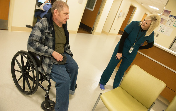 Globe/Roger Nomer<br /> April Seifert, clinical liason at Via Christi, talks with Scott Prince on Wednesday, Dec. 15, at the hospital.