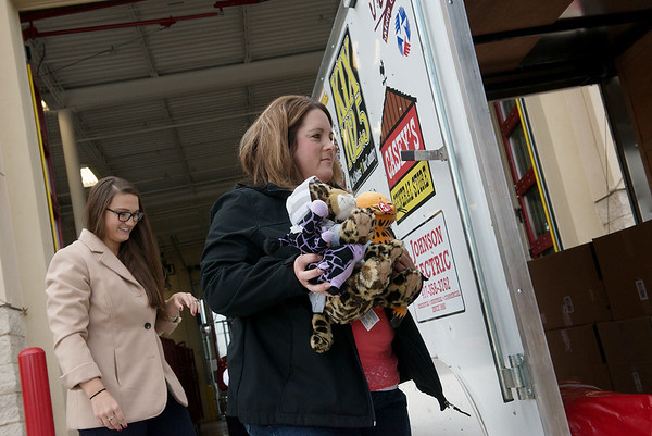 Globe/Roger Nomer<br /> Emily Taylor, left, and Megan Grimes help collect donations on Monday at Fire House No. 4.