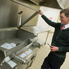 Globe/Roger Nomer<br /> Matt O'Malley gives a tour of the Lord's Dinner kitchen on Wednesday, Dec. 14.