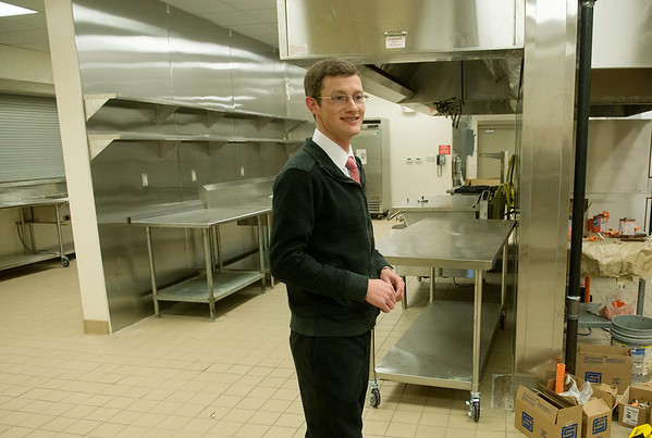 Globe/Roger Nomer<br /> Matt O'Malley gives a tour of the kitchen at the Lord's Dinner in Pittsburg on Wednesday, Dec. 14.
