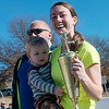 Globe/Roger Nomer<br /> Katie Blakenship accepts her tropy for overall female winner with son Luke, 20 months, following Saturday's Chilly 5K at the south Joplin YMCA.