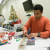 Globe/Roger Nomer<br /> Andrew Fink, house manager at Souls Harbor, wraps presents on Tuesday at the shelter.