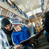 "Globe/Roger Nomer<br /> Donavan Epperson reads ""The Polar Express"" with his son Elias, 3, on Saturday aboard the Polar Express in Webb City."