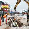 Globe/Roger Nomer<br /> Workers install water pipes on Wednesday along Highway 76 in Branson.