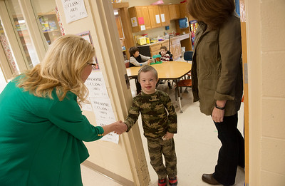 Globe/Roger Nomer Harrison Superintendent Melinda Moss, left, and Woodland Heights Elementary Principal Debbie Wilson greet student Reed Rose on Friday at the school.