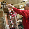 Globe/Roger Nomer<br /> Teresa Mahan arranges a display on Wednesday at the Crawford County Museum.