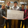 Globe/Roger Nomer<br /> Cheryl Fogarty accepts a check for $1,000 from McAuley marketing students (from left) Jacob Freitas, senior, Miller Stephens, sophomore, Lawrence Asistido, senior, and Fredy Reyes, sophomore, for Labor of Love on Friday at McAuley High School.