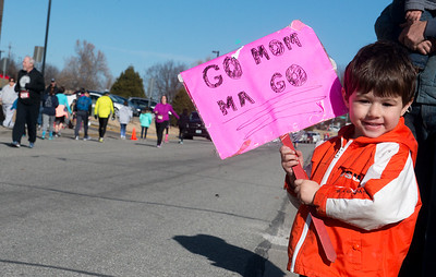 Globe/Roger Nomer David Lodahl, 4, Joplin, cheers on his mother during the Chilly 5K on Saturday at the south Joplin YMCA.