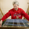 Globe/Roger Nomer<br /> Teresa Mahan demonstrates a two-handed loom on Wednesday at the Crawford County Museum.